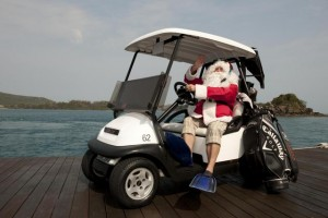 Santa in a golf buggy ready to play at Hamilton Island Golf Club