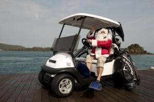 Santa in a golf buggy ready to play at Hamilton Island Golf Club